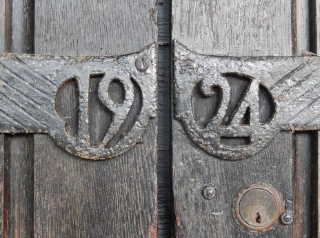 All Saints Church wrought-iron date on porch door