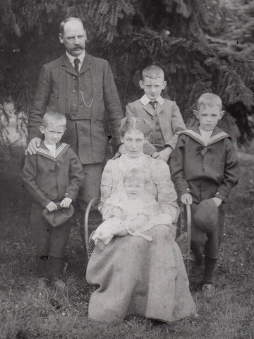 The Gibbons family, William.G. standing, John H is the eldest son, standing to the right of his father in a 3 piece suit