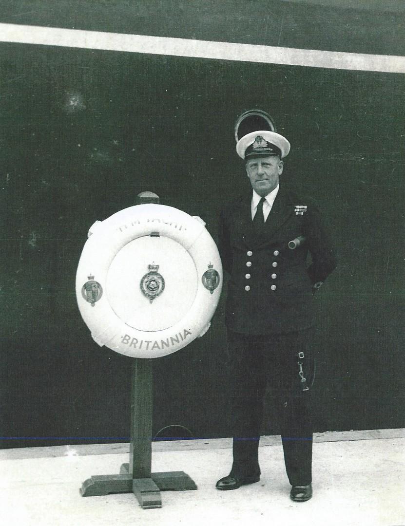 Lieut. Cdr. E. C. Hill, M.V.O., R.N. aboard Britannia