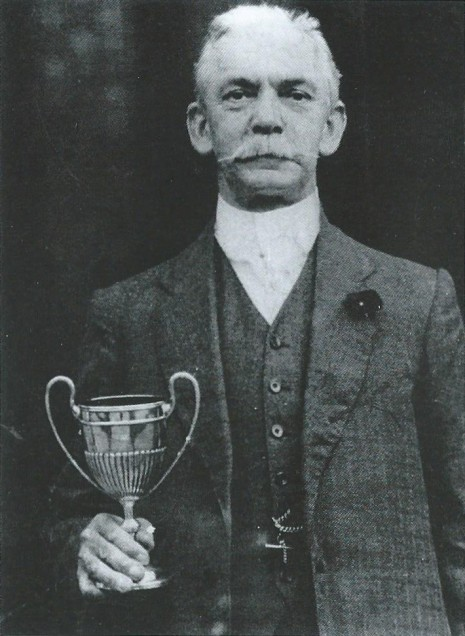 Thomas Glossop holding the Abbeydale Amateur Gardening Society Cup